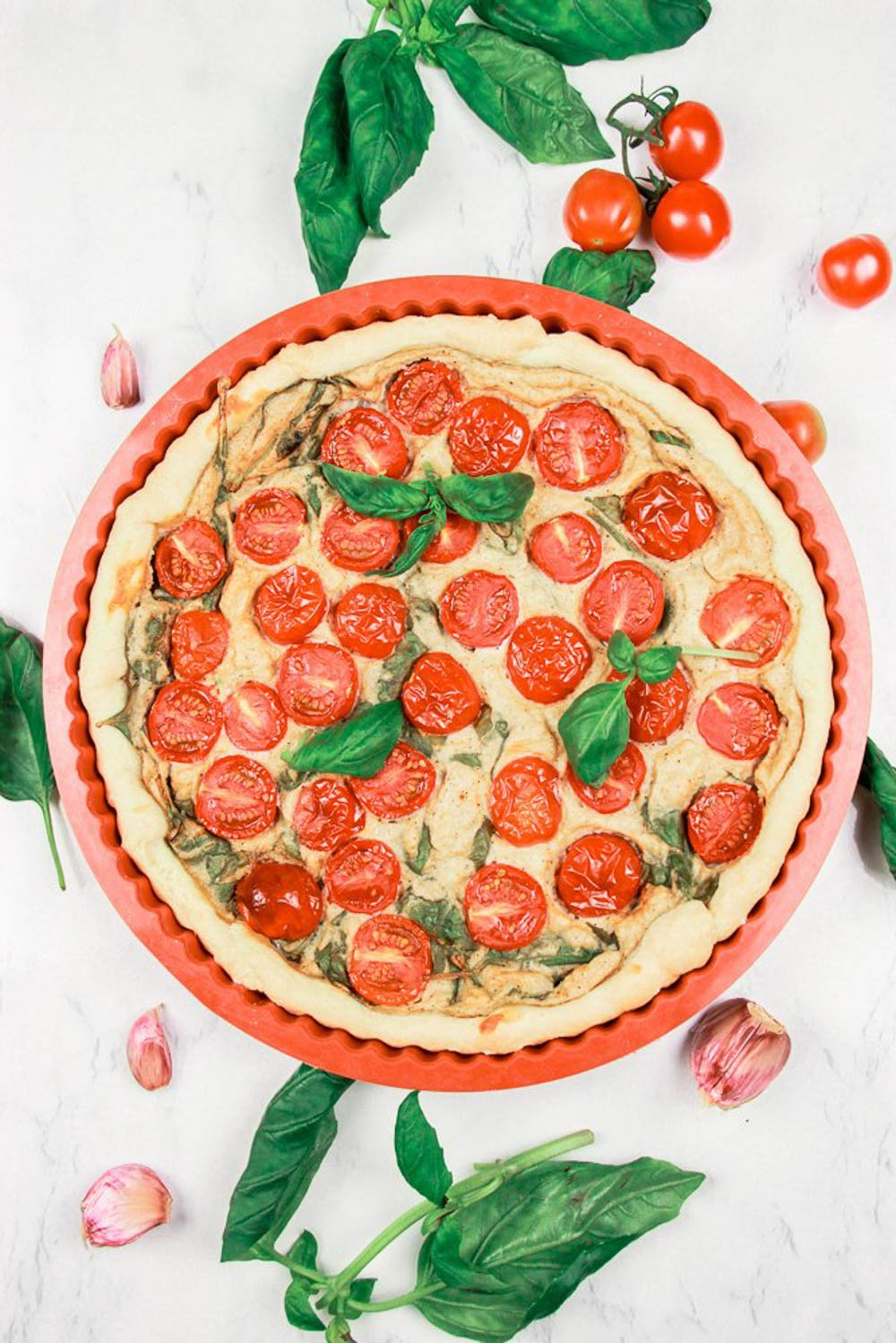This picture shows the finished Healthy Spinach Tomato Quiche.
