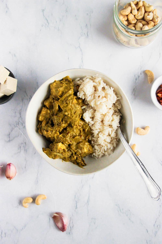 Green vegan Palak Paneer served with rice