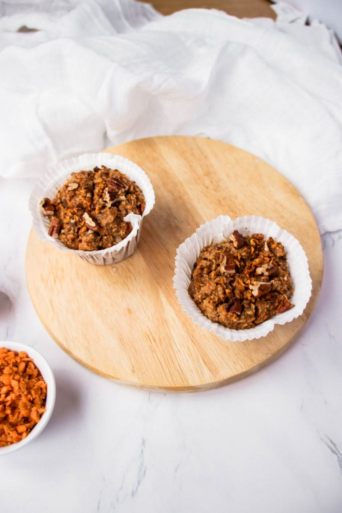 Healthy Carrot Cake Muffins with Carrots and Pecans on the side