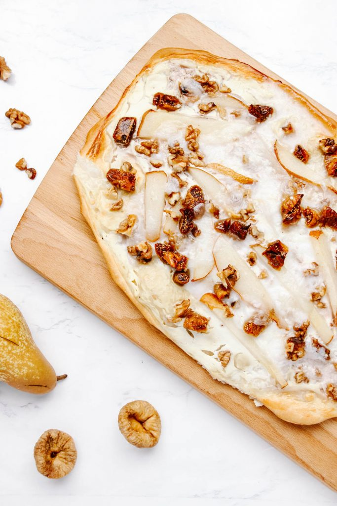 Pear and Walnut Tarte Flambée served on a wooden board
