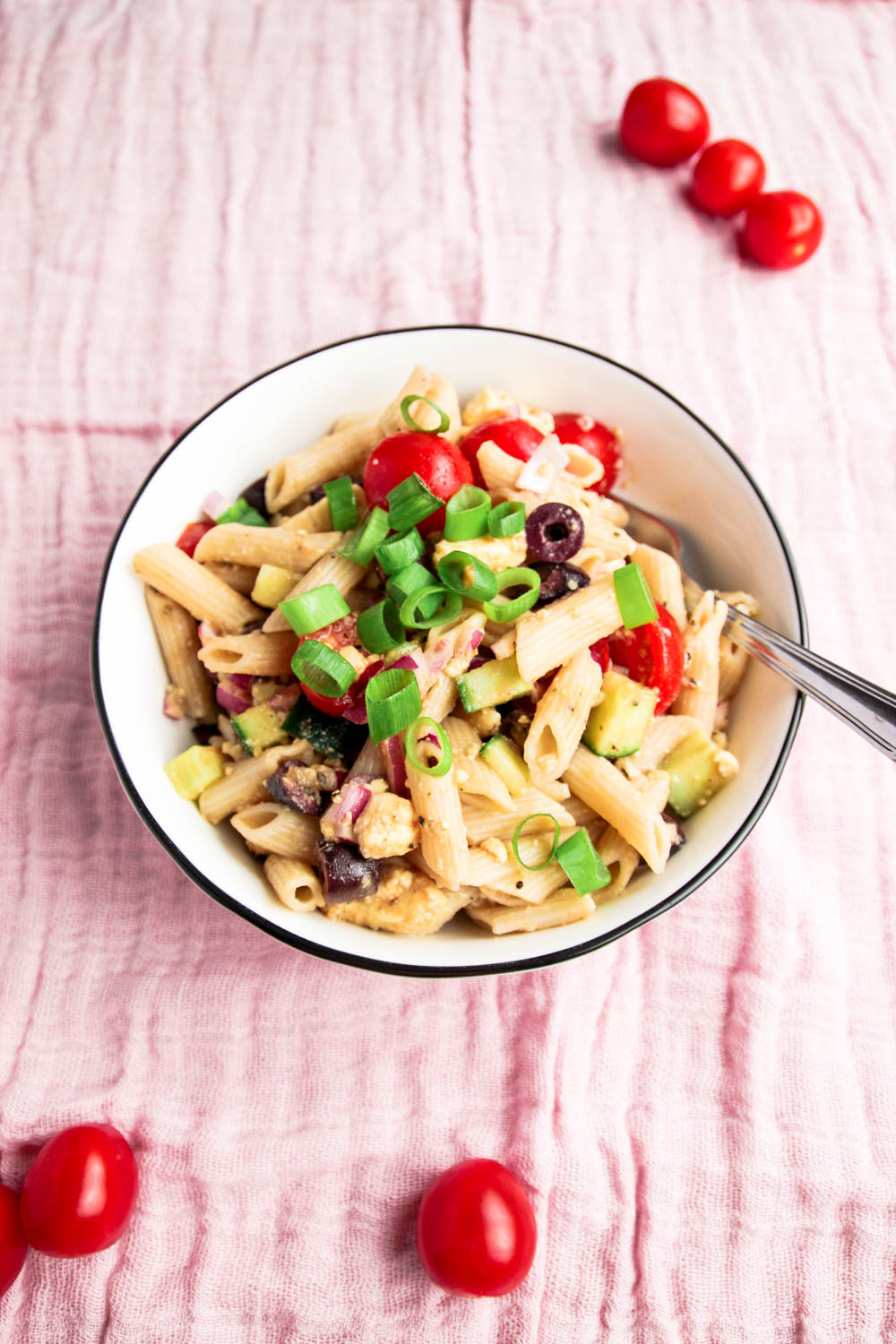 Fresh Summer Pasta Salad with tomatoes on the side.