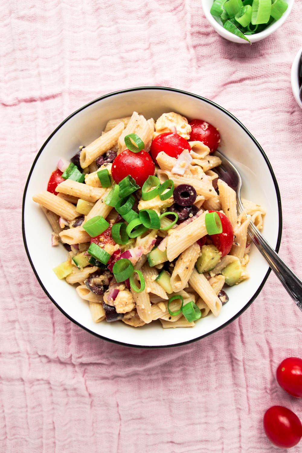 Fresh Summer Pasta Salad with tomatoes and spring onions on the side.