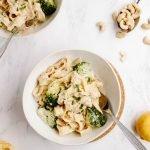 Creamy vegan fettuccine alfredo with broccoli florets.