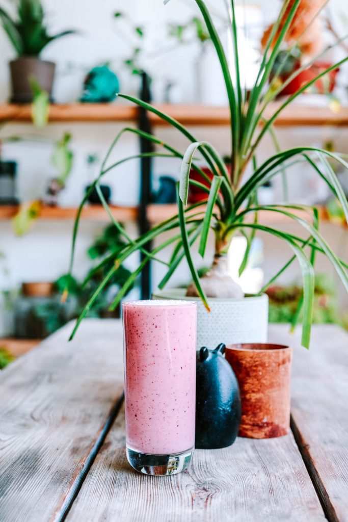 Purple Power Detox Smoothie placed on a wooden table
