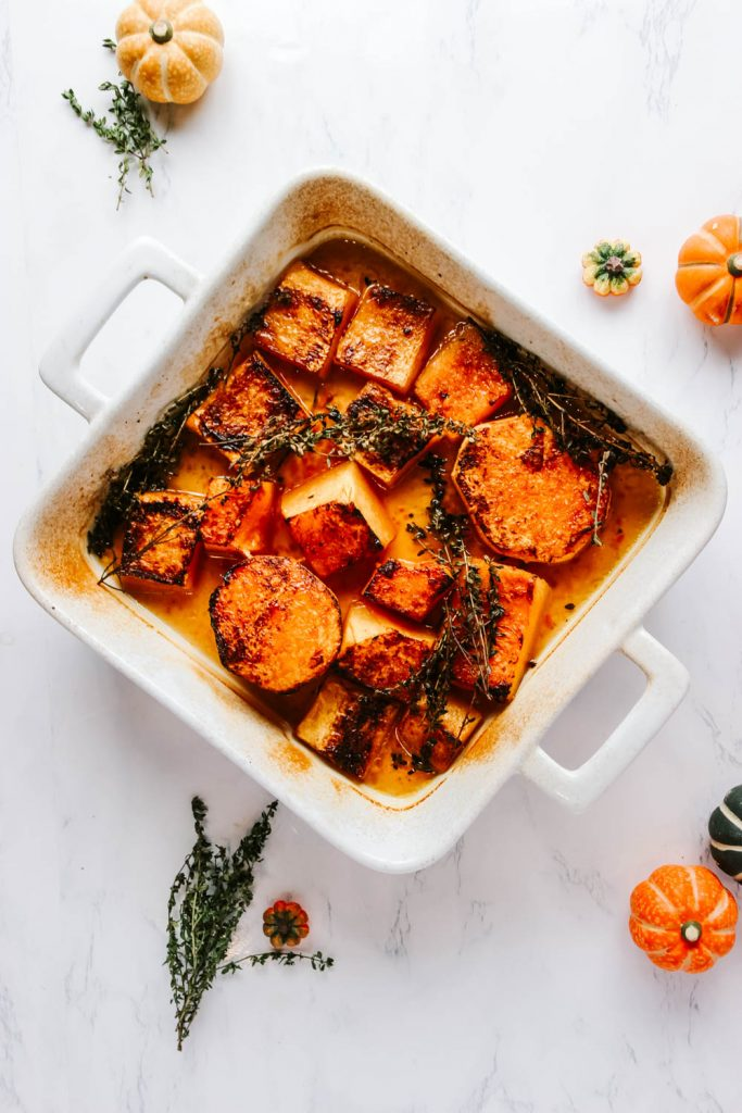 Butternut Squash Fondant in a white baking dish garnished with thyme.